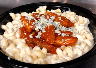 buffalo chicken mac & cheese piled high with tenders and crumbled blue cheese